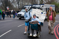 Disabled protester in front of riot vans, London Royalty Free Stock Image