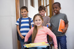 Disabled pupil with his friends in classroom Stock Photography