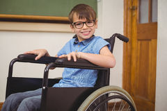 Disabled pupil smiling at camera