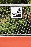 Disabled ramp sign on a fence Royalty Free Stock Photography