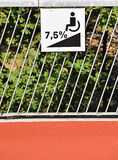 Disabled ramp sign on a fence Royalty Free Stock Photos