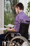 Disabled reading a book Royalty Free Stock Image