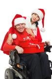 Disabled Santa Claus and Santa Girl Royalty Free Stock Image