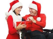 Disabled Santa Claus and Santa Girl Stock Images