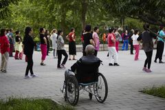 Disabled senior and dancing healthy women stock photos