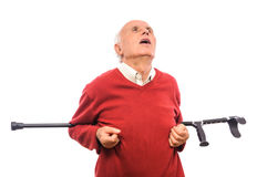 Disabled senior man doing exercise with crutch Royalty Free Stock Image