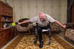 Disabled senior man leaned and doing exercises Stock Image