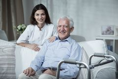 Disabled senior man and nurse. Disabled senior men and beauty caring nurse Royalty Free Stock Photography