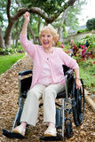 Disabled Senior Success. Disabled senior lady in pink, excited about achieving her health goals Stock Images