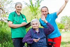 Disabled assisted senior woman Royalty Free Stock Photography