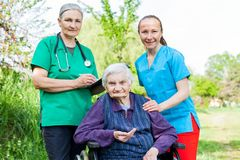 Disabled assisted senior woman Stock Photography