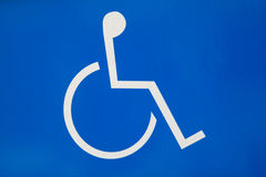 Disabled Sign. Blue disabled sign showing individual in wheelchair Royalty Free Stock Image