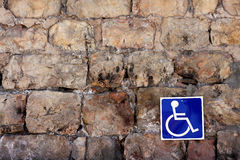 Disabled sign. A sign for disabled people on an old wall Stock Photography