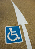 Disabled sign with an arrow Stock Photo