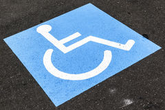 Disabled sign on asphalt Stock Photos