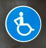 Disabled sign. Blue sign with man in a wheelchair for disabled people stock image
