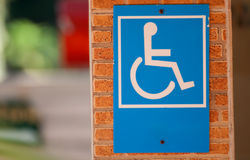Disabled sign on brick wall Stock Photo