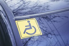 Disabled sign on the car glass. Royalty Free Stock Image