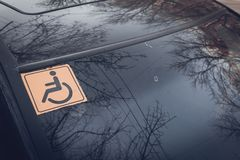 Disabled sign on the car glass. Stock Photo