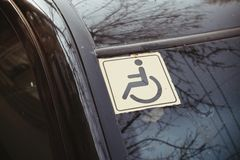 Disabled sign on the car glass. Royalty Free Stock Photos