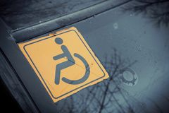Disabled sign on the car glass. Stock Images