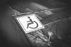 Disabled sign on the car glass. Royalty Free Stock Photo