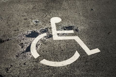 Disabled sign at a parking lot Stock Photos