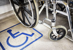 Disabled sign and wheel chair Royalty Free Stock Photos