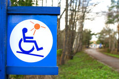 Disabled  sign wood label. In park public Stock Photo