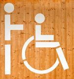 Disabled sign on a wooden wall Royalty Free Stock Photo