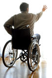 Disabled sitting in a wheelchair in the room near the window Stock Photo