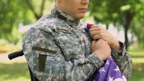 Disabled soldier coming to memorial to commemorate all heroically dead soldiers. Stock footage stock footage