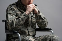 Handicapped military young male praying stock photo