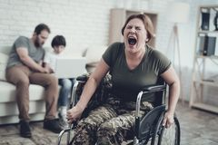 Disabled Soldier In Wheelchair. Suffer From Pain. Meeting After War. Son And Husband Background. Camouflage Uniform. Family Concept. Paralyzed Soldier. Home royalty free stock images