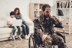 Disabled Soldier In Wheelchair. Suffer From Pain. Disabled Soldier In Wheelchair. Suffering From Pain. Meeting After War. Son And Wife Background. Camouflage stock images