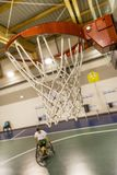Disabled sport men in action while playing indoor basketball. Disabled sport man in action while playing indoor basketball at a basketball court stock image