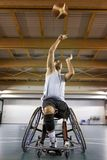 Disabled sport men in action while playing basketball. Disabled sport man in action while playing indoor basketball at a basketball court royalty free stock photo