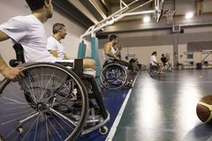 Disabled sport men in action while playing basketball. Disabled sport men in action while playing indoor basketball at a basketball court stock photos