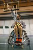 Disabled sport men in action while playing basketball. Disabled sport man in action while playing indoor basketball at a basketball court stock photos