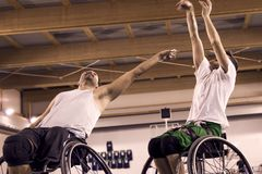 Disabled sport men in action while playing basketball. Disabled sport men in action while playing indoor basketball at a basketball court royalty free stock images