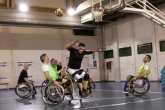 Disabled sport men in action while playing basketball. Disabled sport men in action while playing indoor basketball at a basketball court royalty free stock photos