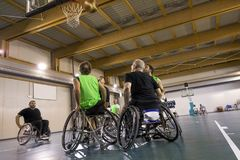 Disabled sport men in action while playing basketball. Disabled sport men in action while playing indoor basketball at a basketball court stock photography