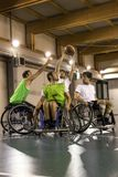 Disabled sport men in action while playing basketball. Disabled sport men in action while playing indoor basketball at a basketball court stock image