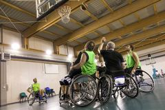 Disabled sport men in action while playing basketball. Disabled sport men in action while playing indoor basketball at a basketball court stock images