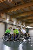 Disabled sport men in action while playing indoor basketball. At a basketball court stock photo