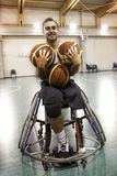 Disabled sport men in action while playing indoor basketball. Disabled sport man in action while playing indoor basketball at a basketball court stock images