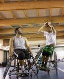 Disabled sport men in action while playing indoor basketball. At a basketball court royalty free stock photo