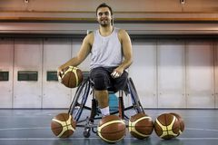 Disabled sport men relaxation while playing basketball. Disabled sport man relaxation while playing indoor basketball at a basketball court Stock Photography