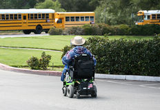 Disabled Student. On the way to the school bus Royalty Free Stock Photos