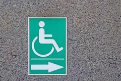 Disabled symbol On the green Stick to the marble walls Stock Image